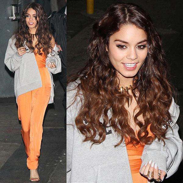 Vanessa Hudgens styled her Giuseppe Zanotti sandals with a Catherine Malandrino strapless silk jumpsuit in orange