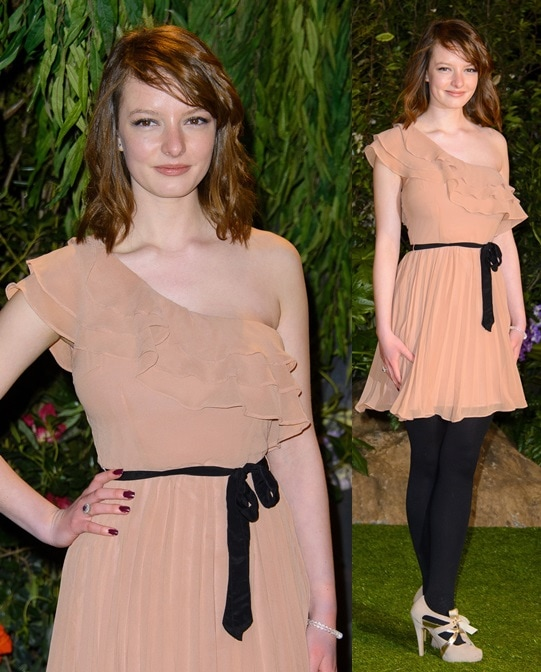 Dakota Blue Richards mixing light with dark and punctuating her outfit with ribbon-tie pumps