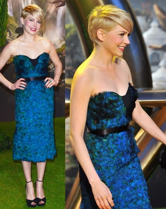 Michelle Williams in a feathered dress from Burberry at the European premiere of Oz: The Great And Powerful