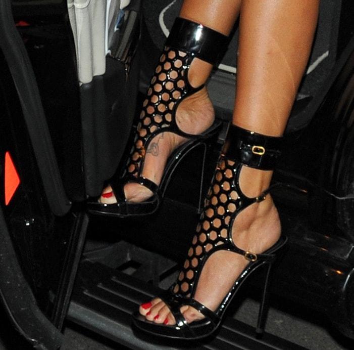 Tamara Ecclestone wearing perforated sandals from Alexander McQueen