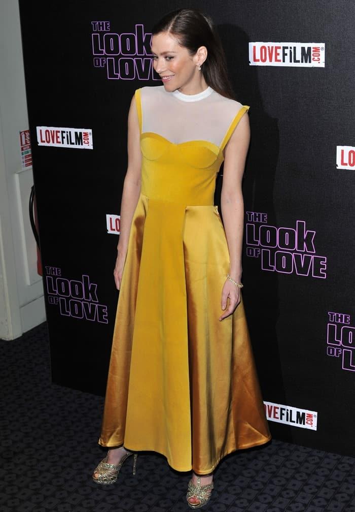 Anna Friel in open back mustard yellow dress