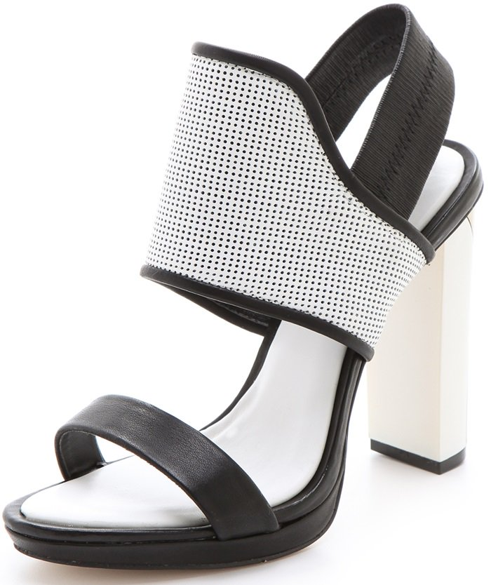 Two-tone leather sandals gain a touch of athletic appeal from a notched, perforated leather panel and an elastic slingback strap, while a sleek swath of metallic acrylic adds shine at the chunky heel.