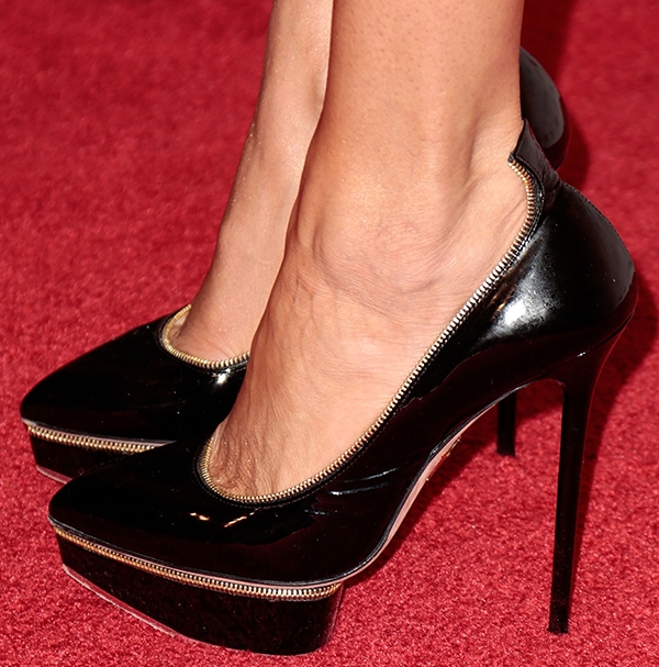 Brandi Glanville shows off her feet in black platform pumps with zipper trimming