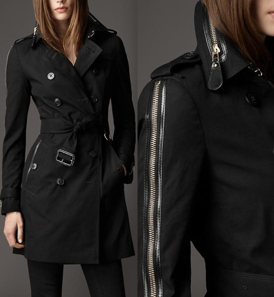 Golden leather-tipped zippers accentuate the collar and trace the long sleeves of an ultra-modern trench coat cut from water-repellent gabardine