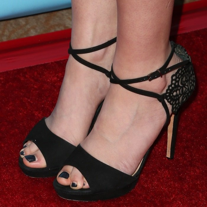 Carly Chaikin's attractive feet and sexy toes in black peep-toe shoes