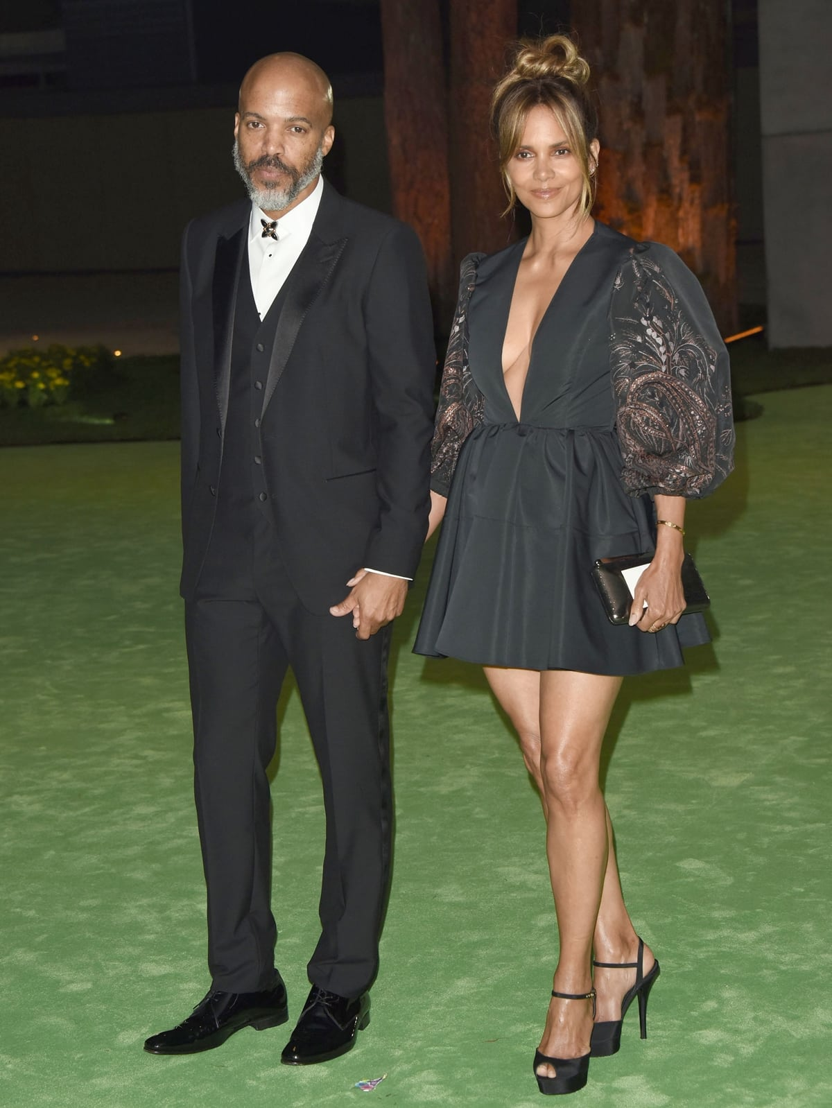 Joined by her boyfriend Van Hunt, Halle Berry wore a puff-sleeve black Etro mini dress with matching Dolce & Gabbana peep-toe heels for The Academy Museum of Motion Pictures Opening Gala