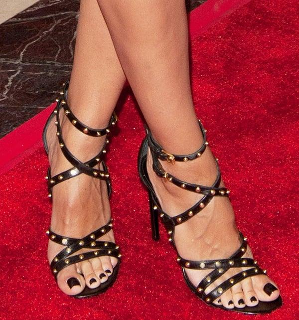 Heidi Klum wearing studded sandals from Saint Laurent