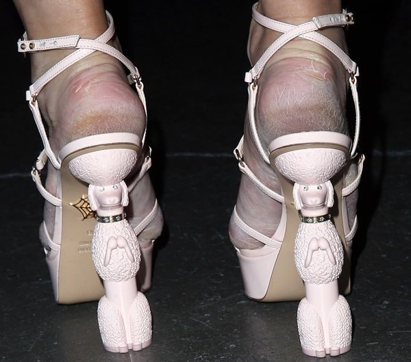 Holly Madison's cracked feet in Charlotte Olympia sandals with dancing, upright-standing poodles