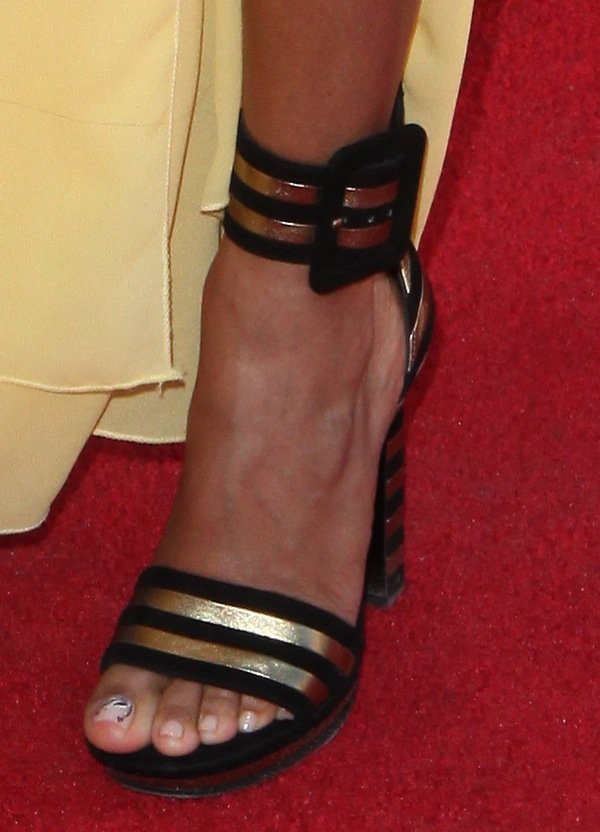Jada Pinkett-Smith showing off her feet in black-and-gold Saint Laurent ankle-cuff 'Paloma' sandals