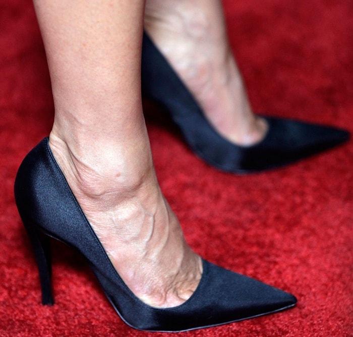 Jennifer Aniston wearing pointy stiletto pumps from Dior