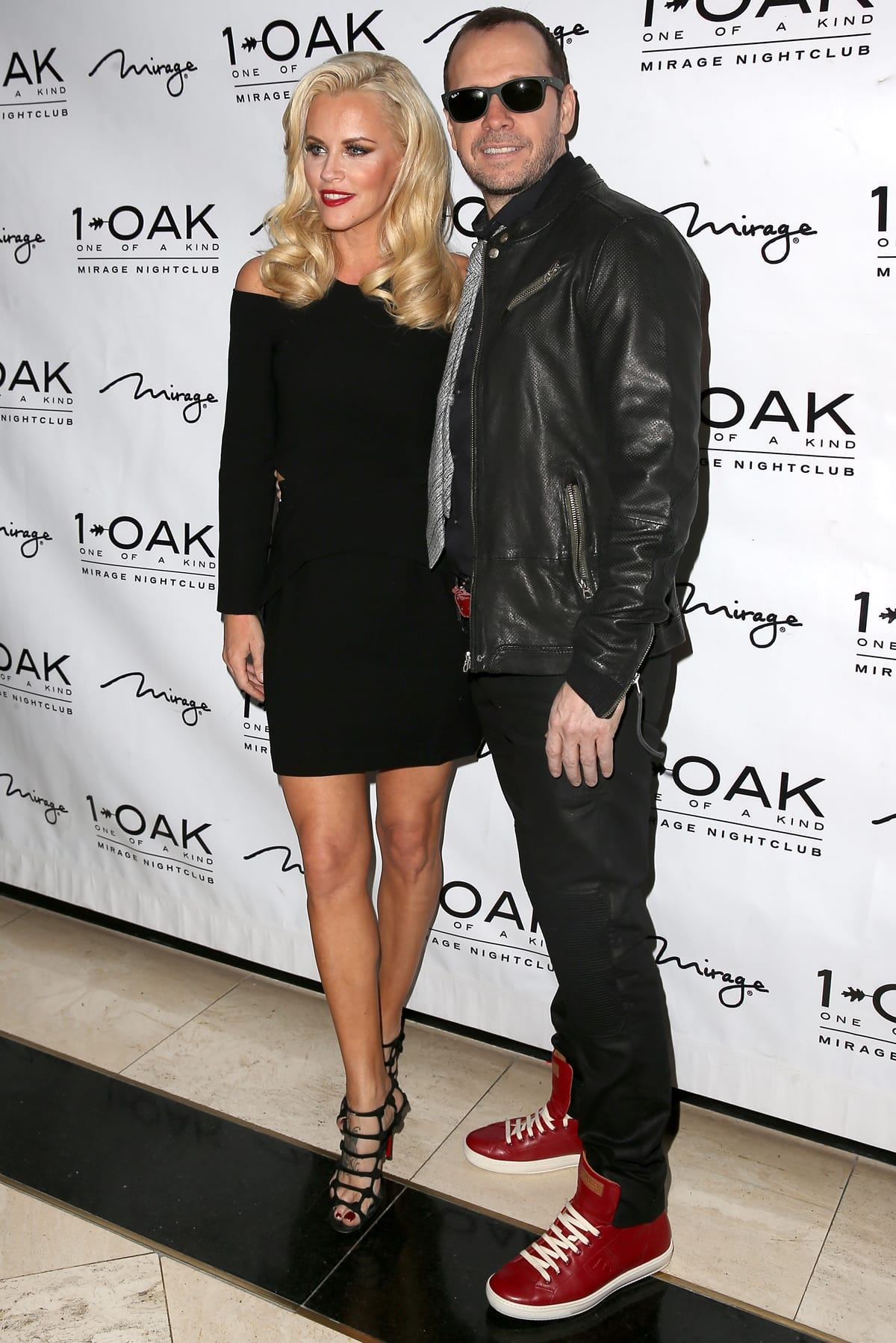Actress/television host Jenny McCarthy and singer/actor Donnie Wahlberg arrive at 1 OAK Nightclub