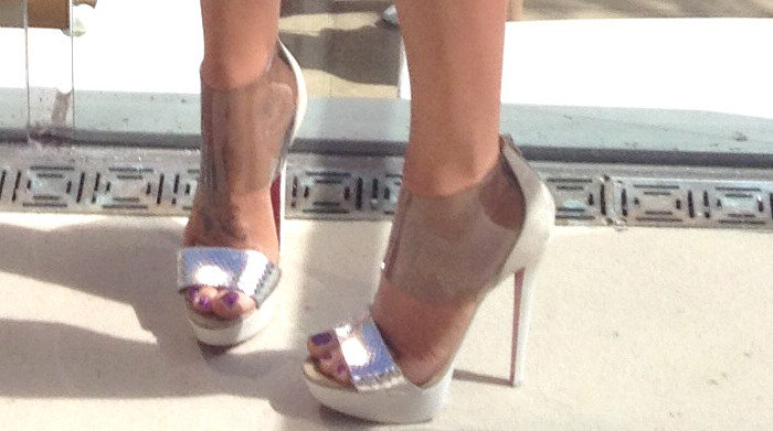 Jenny McCarthy's feet in silver-and-clear Christian Louboutin heels