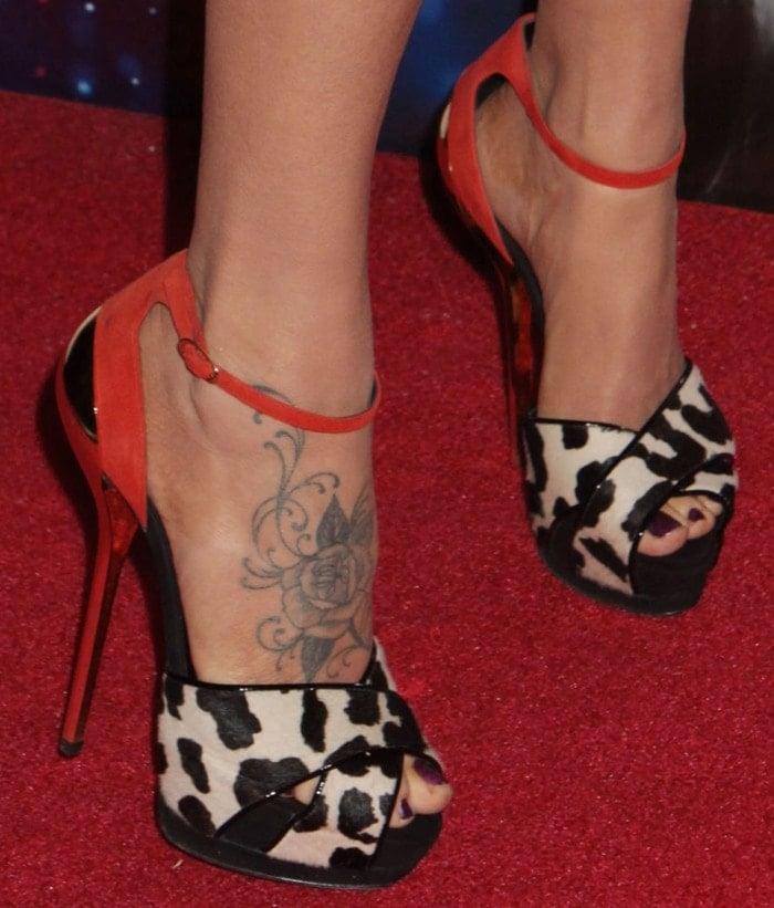 Jenny McCarthy's feet and foot tattoos in animal-print Giuseppe Zanotti heels