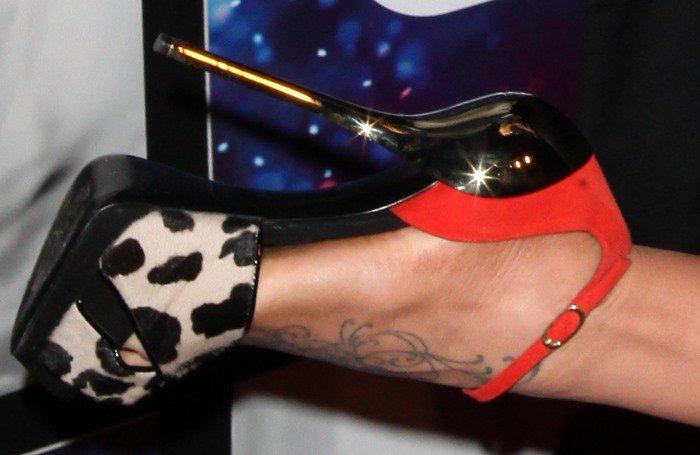 Jenny McCarthy's foot tattoo in animal-print Giuseppe Zanotti stilettos