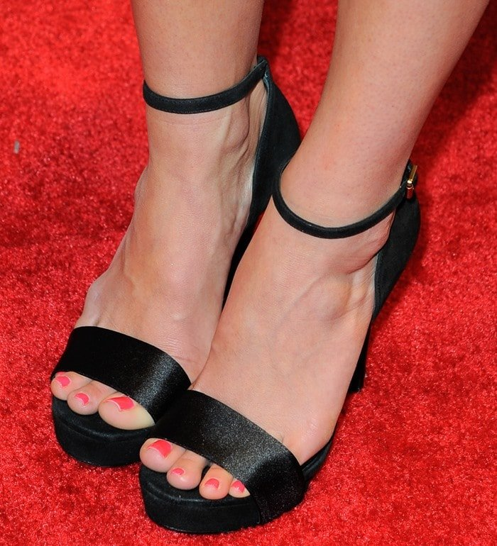 A closer look at Jessica's black ankle-strap sandals