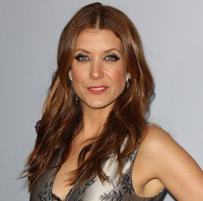 Kate Walsh wore her hair curly and loose, and a soft pink pout and smokey eyes served as the finishing touches to her look