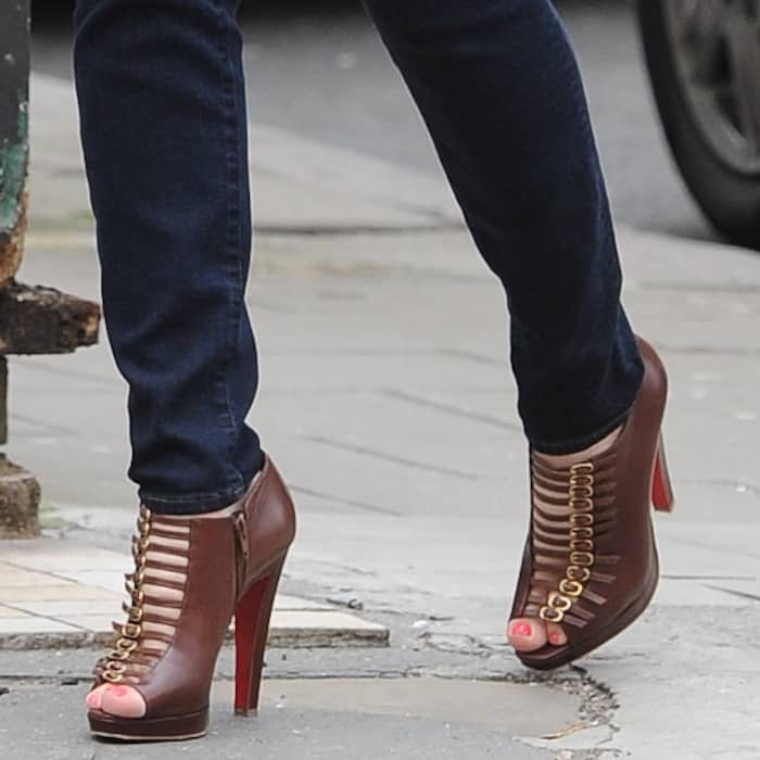 Kelly Brook shows off her feet in Christian Louboutin brown leather buckled 'Manon' booties