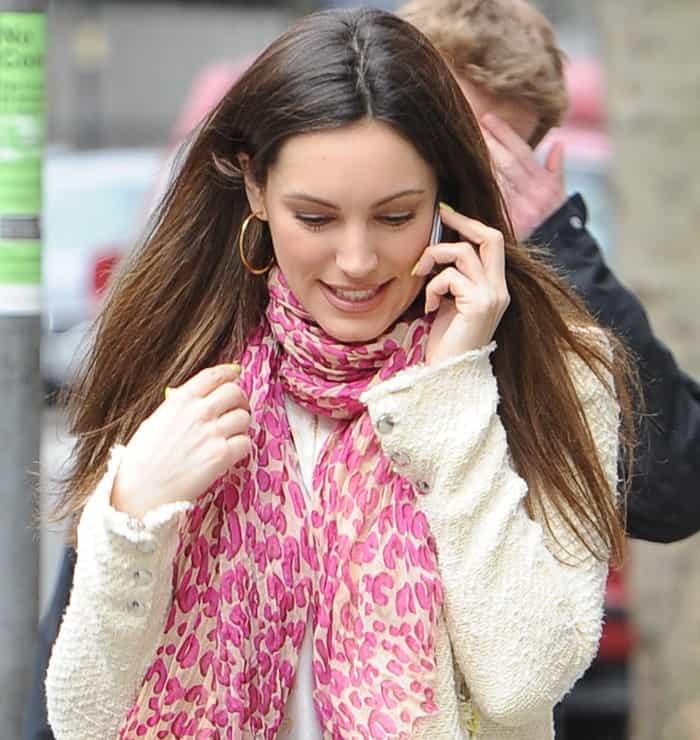 Kelly Brook wearing a pink printed scarf