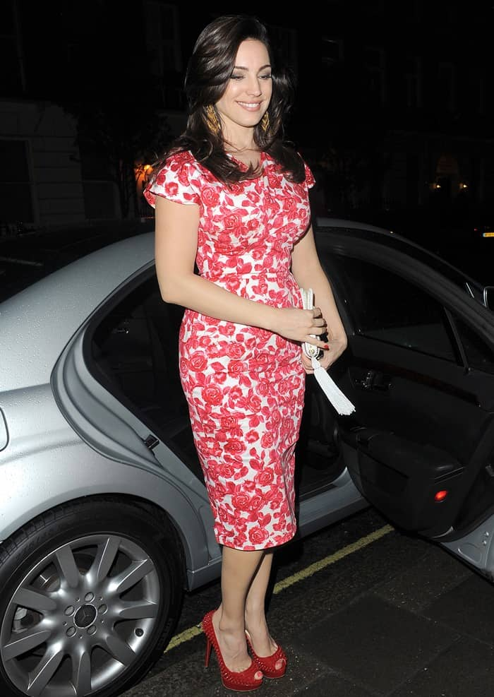Kelly Brook was all smiles at the camera as she left ITV Studios after filming her appearance on 'Celebrity Juice'