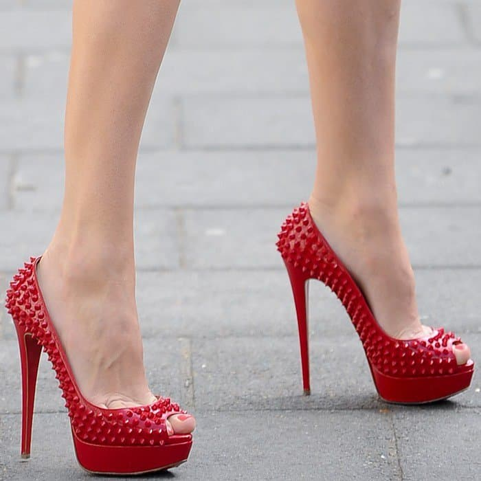 Kelly Brook wearing red 'Lady Peep Spikes' heels