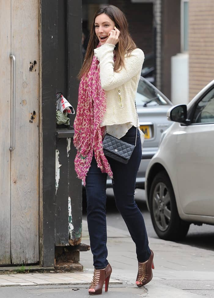 Kelly Brook chatting on her mobile phone while out and about in Soho, London on April 15, 2013