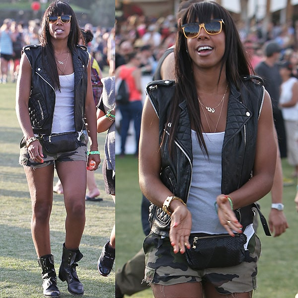 Kelly Rowland is one tough chick in a leather biker vest, camo shorts, combat boots, and ... a fanny pack?