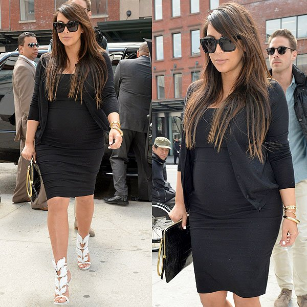 Kim Kardashian contrasted the stark white sandals with a fitted black dress, a black cardi, big black sunglasses, and a black croc-embossed clutch