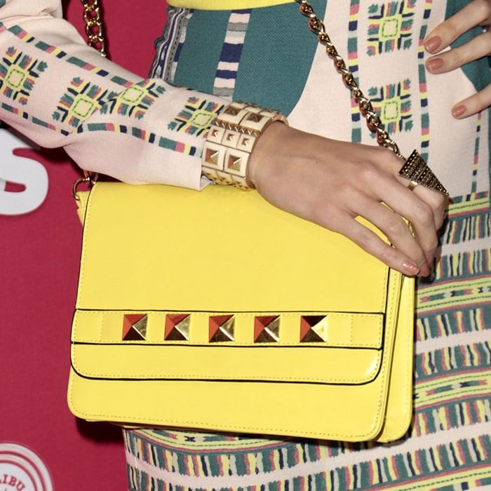 Louise Roe toting a studded yellow purse