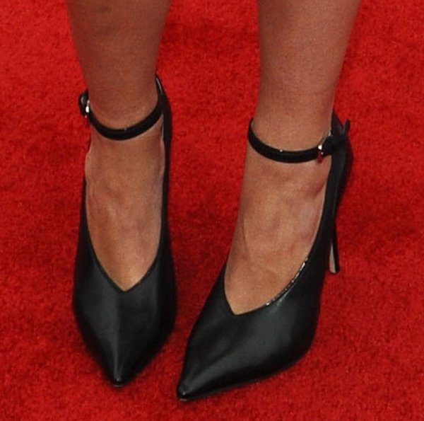 Maia Mitchell shows off her feet in black shoes
