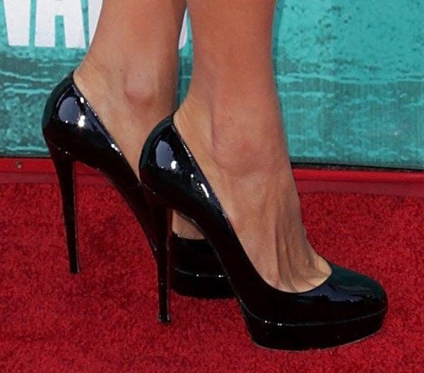 Paris Hilton wearing Christian Louboutin pumps