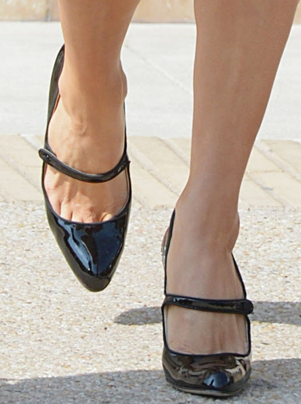 Paris Hilton wearing black Mary Jane pointed-toe pumps