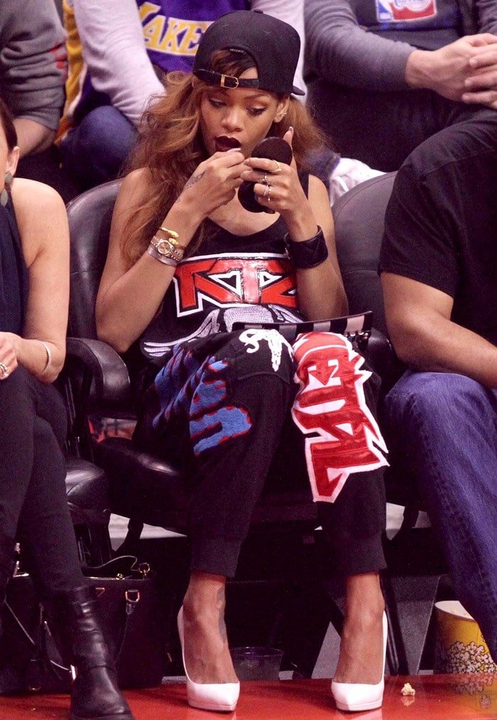 Rihanna watching the Lakers vs. Clippers game at the Staples Center in Los Angeles on April 7, 2013