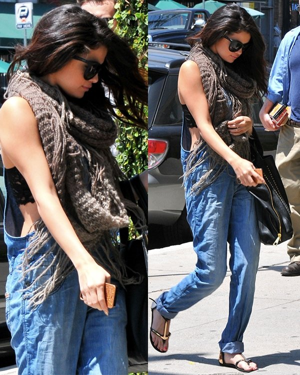 Selena Gomez sported a blue denim dungaree that left her lacy black bra exposed on the sides