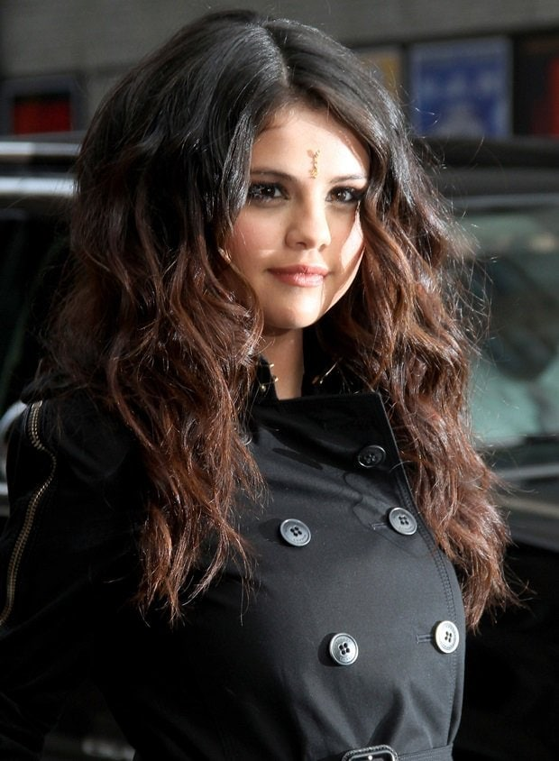 Selena Gomez wearing a bindi, a decorative mark worn in the middle of the forehead by Indian women, especially Hindus