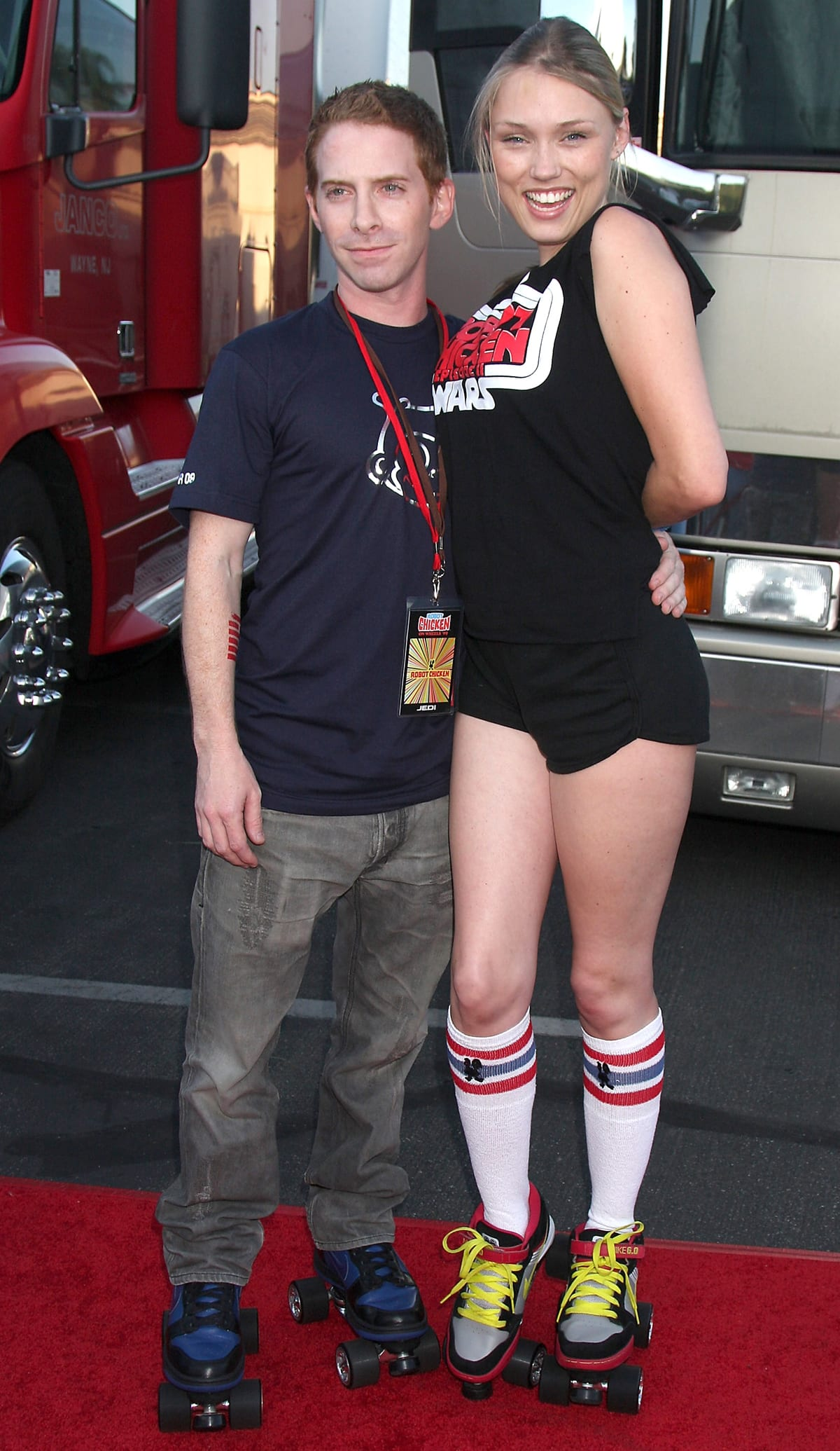 """Seth Green (L) and his girlfriend Clare Grant arrive at Adult Swim's """"Robot Chicken: Skate Party"""" bus tour"""