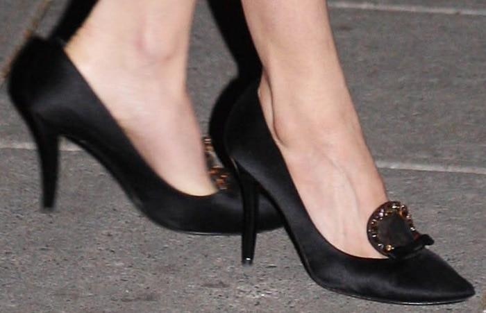 Sienna Miller's jeweled black satin pumps