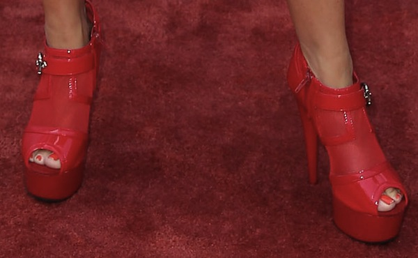 Tobi Lee in red ankle booties