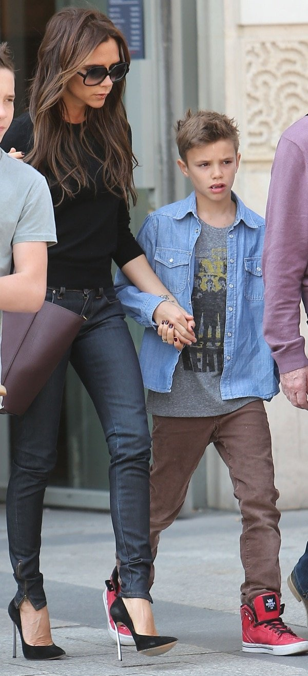 Victoria Beckham and her son Romeo James are seen leaving the 'NIKE' store on the Champs-Elysees Avenue