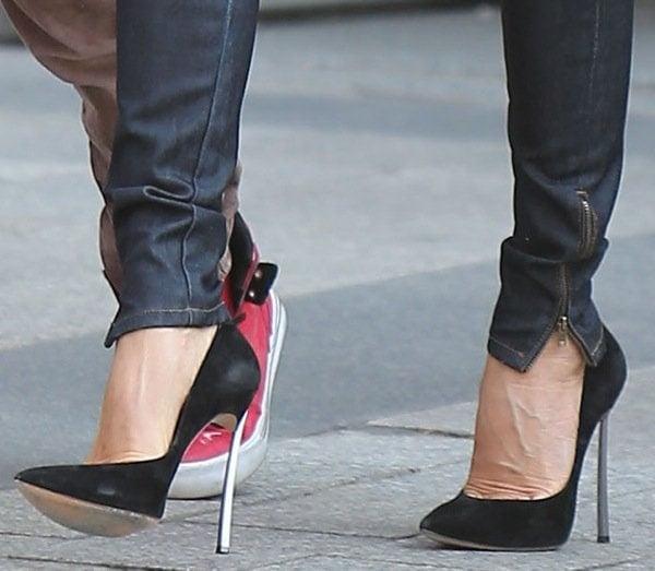 Victoria Beckham wearing ultra-high silver-heeled pumps