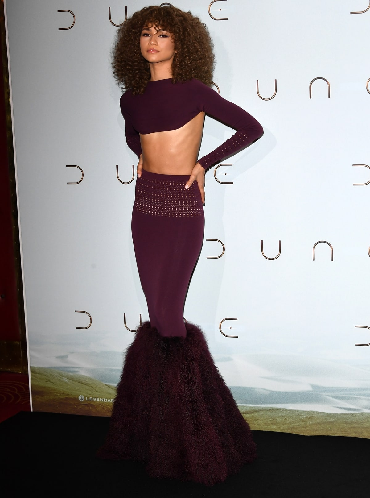Zendaya in a tiny Alaïa high-cut long-sleeved top and bodycon skirt