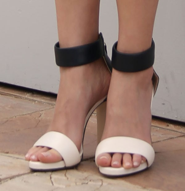 Ahna O'Reilly wearingblack-and-white sandals by Bionda Castana