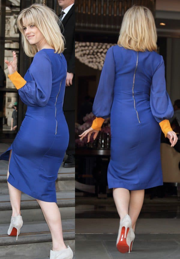 Alice Eve wearing a body-hugging blue dress paired with Diptic booties from Christian Louboutin