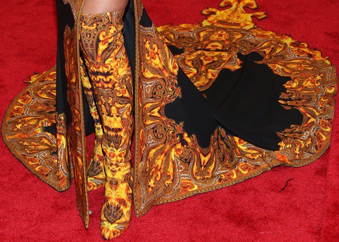Beyoncé Giselle Knowles-Carter styled her dress with over-the-knee-boots in the same gold paisley fabric