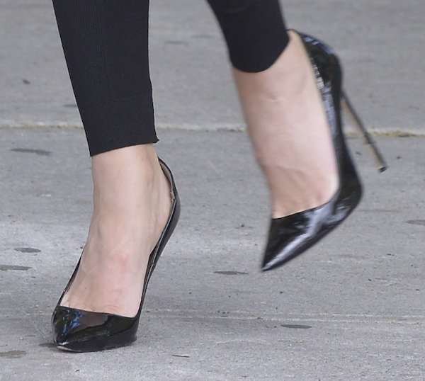 Wrapping up with Casadei black patent leather pumps