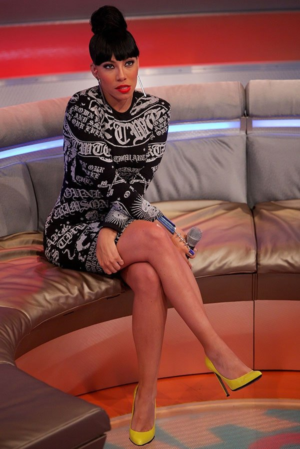 Bridget Kelly Today wore a black-and-gray tight-fitting dress by KTZ and added a pop of color to her ensemble by wearing a pair of bright yellow pumps
