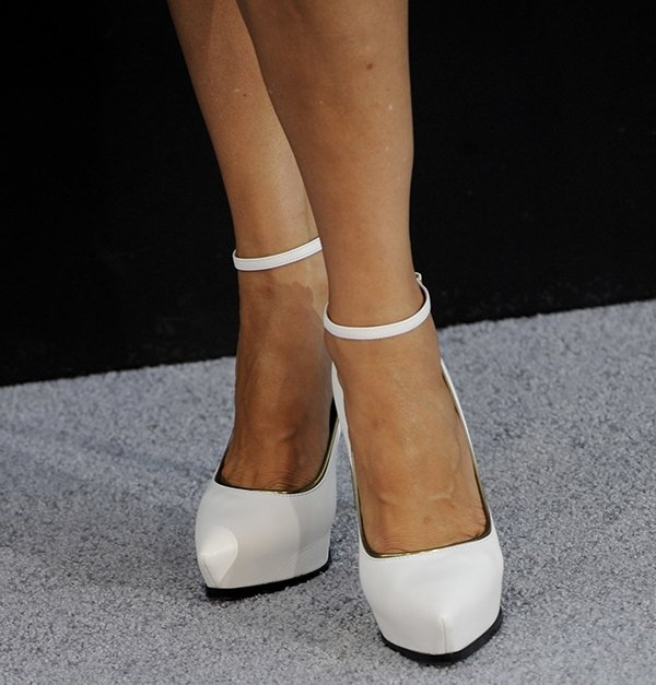 Catherine Bell rocks white platform pumps by Lanvin
