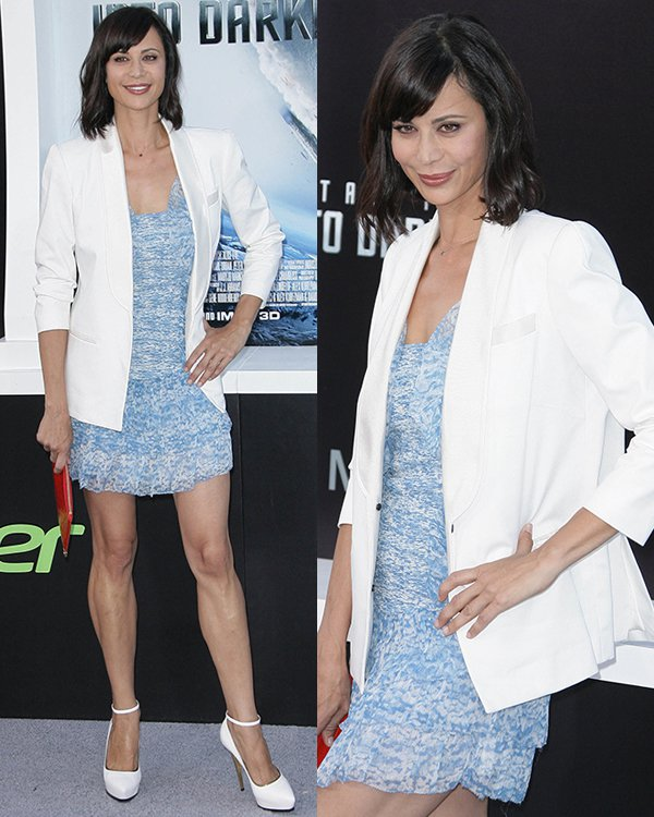 Catherine Bell looked summery chic in her printed light blue dress, which she styled with a white blazer