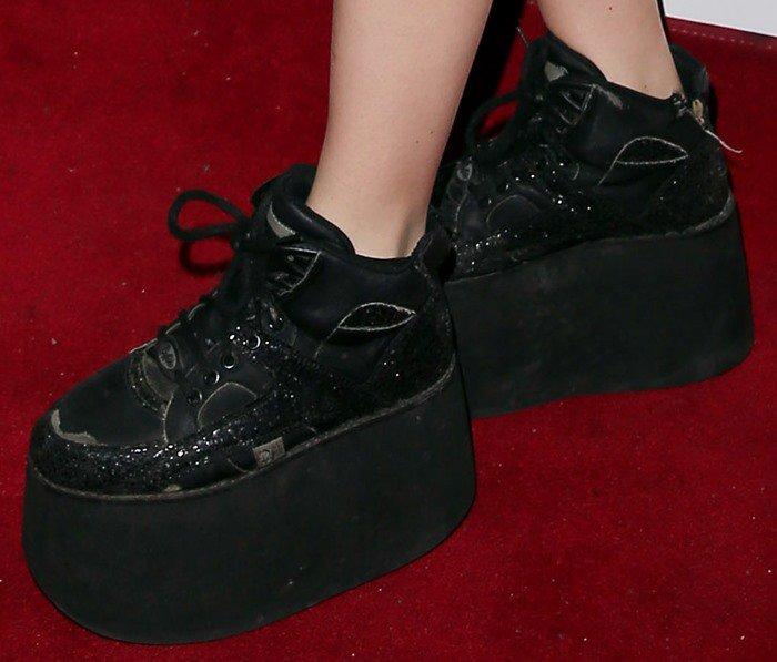 Charli XCX's feet in Buffalo Classic sneakers