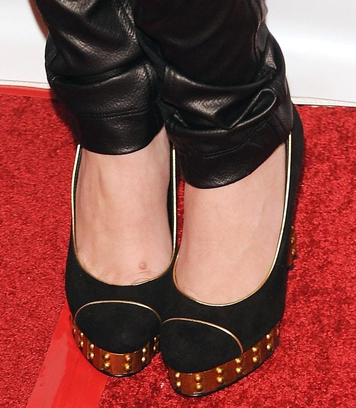 Cher Lloyd wearing gold platform heels