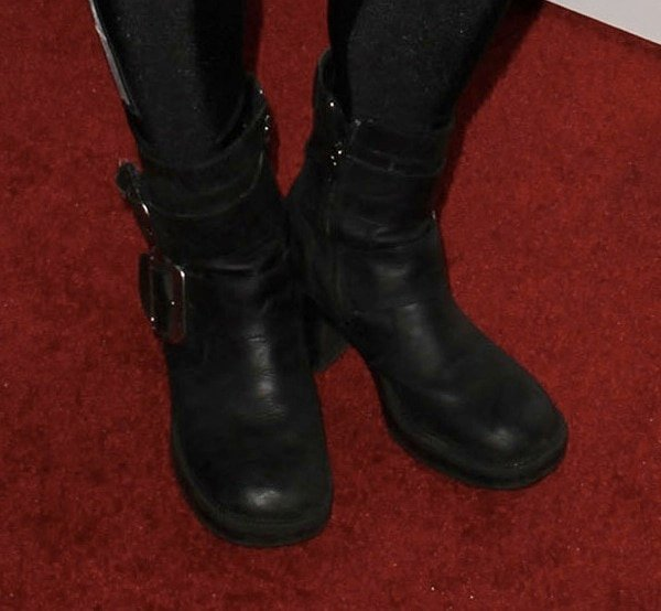 Buckled biker boots complementing DJ Rap's outfit
